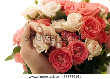 Beautiful woman hands with flowers