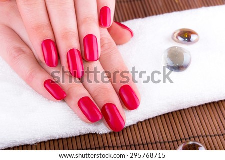 Beautiful woman hands with French manicure nails - stock photo