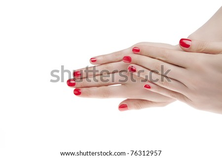 beautiful woman hands with red manicure. isolated on white background