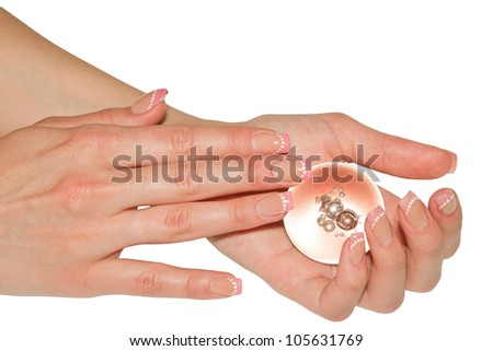 Beautiful woman hands with sphere. Isolated on white