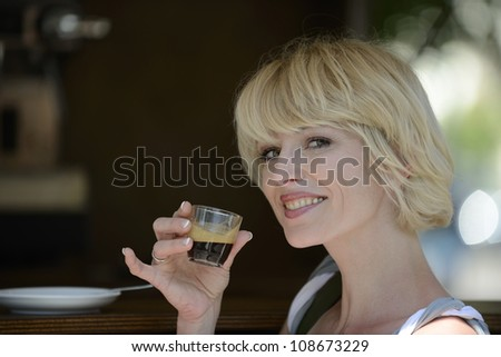 Beautiful woman having a coffee break - stock photo