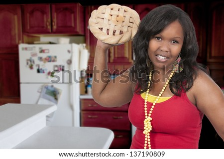Beautiful woman having a friendly pie fight - stock photo