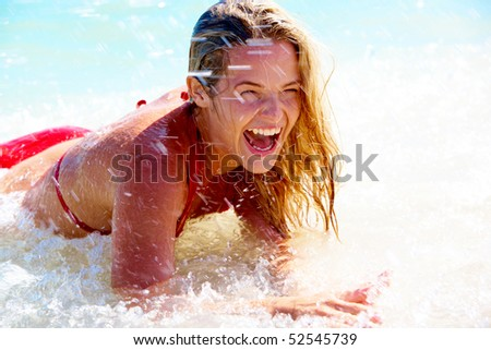 Beautiful woman having a fun while swimming in the lake - stock photo