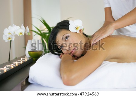 Beautiful woman having a massage - stock photo