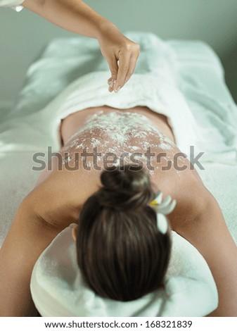Beautiful woman having a wellness back massage  - stock photo