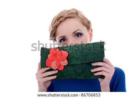 beautiful woman hidding her face with a small purse - stock photo