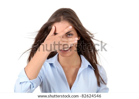 Beautiful woman hiding her eyes with fingers
