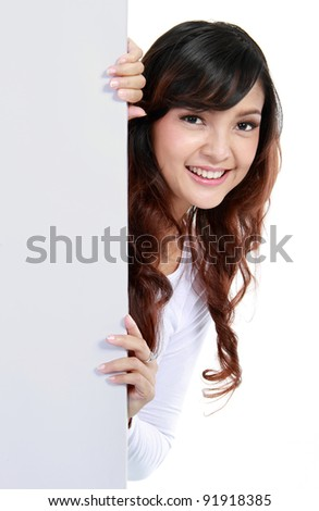 beautiful woman holding a blank billboard. isolated over white background - stock photo
