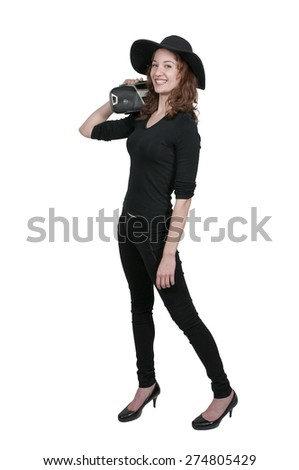 Beautiful woman holding a boom box on her shoulder - stock photo