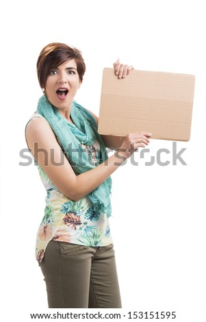 Beautiful woman holding a cardboard and admired with something on it, isolated over a white background - stock photo