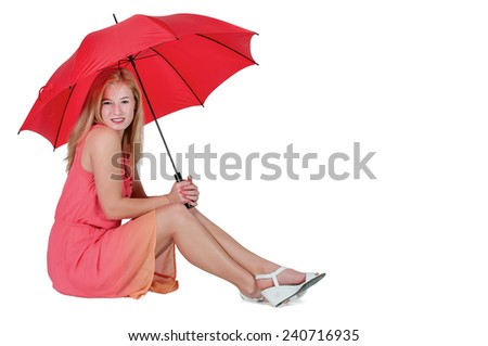 Beautiful woman holding a colorful umbrella - stock photo