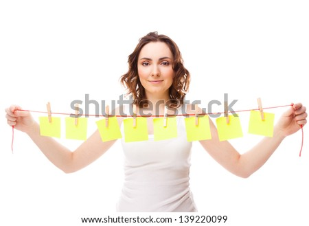 Beautiful woman holding a cord with eight sticky isolated on white - stock photo
