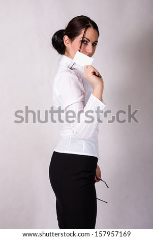 beautiful woman holding a credit card  - stock photo