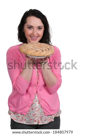 Beautiful woman holding a freshly baked pie