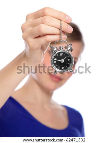 beautiful woman holding a small alarm clock in her hand, isolated on white - stock photo