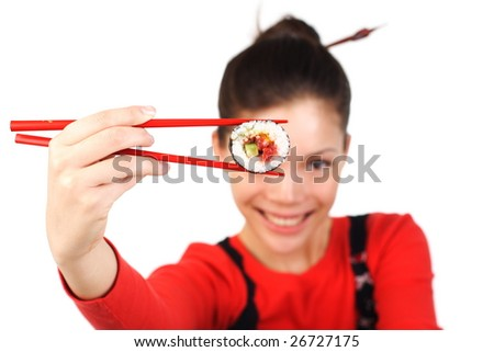 Beautiful woman holding a tuna maki sushi. Sushi is in focus, model is out of focus. Isolated on white.