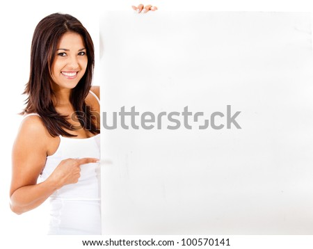 Beautiful woman holding a white placard and pointing - isolated - stock photo