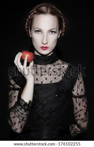 Beautiful woman holding an apple - stock photo