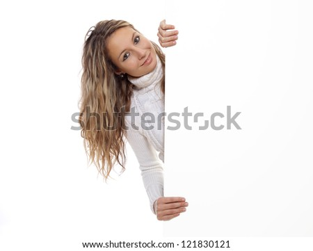 Beautiful woman holding an empty board - stock photo