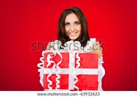 beautiful woman holding big Christmas present - stock photo