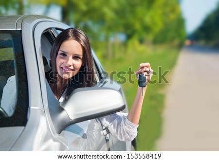 Beautiful woman holding car keys - stock photo