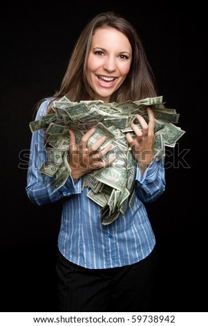Beautiful woman holding cash money - stock photo