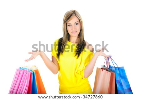 Beautiful woman holding colorful shopping bags