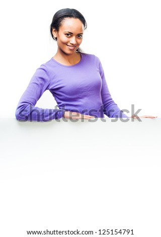 Beautiful woman holding empty white board - stock photo