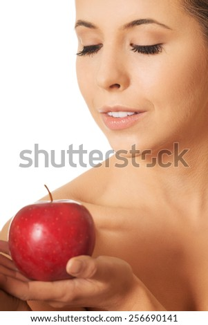 Beautiful woman holding fresh apple - stock photo
