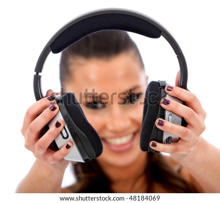 beautiful woman holding headphones isolated over a white background - stock photo