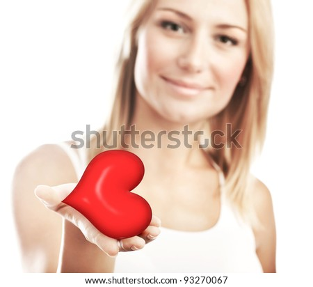 Beautiful woman holding heart in hand, sensual female portrait isolated on white background, cute girl, conceptual image of health care and love, selective focus, shallow dof