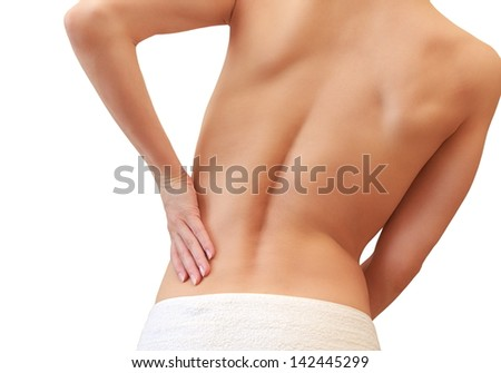 Beautiful woman holding her back in sport pain isolated on white background - stock photo