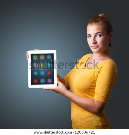 beautiful woman holding modern tablet with colorful icons