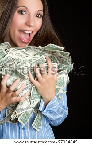 Beautiful woman holding money - stock photo