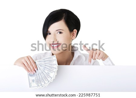 Beautiful woman holding money clip