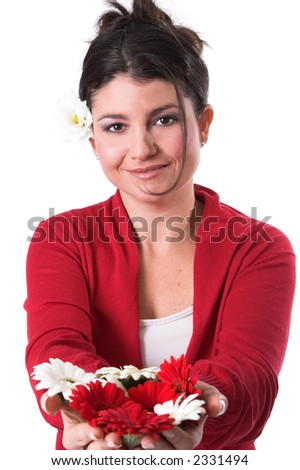 beautiful woman holding out flowers in her hands in front of her