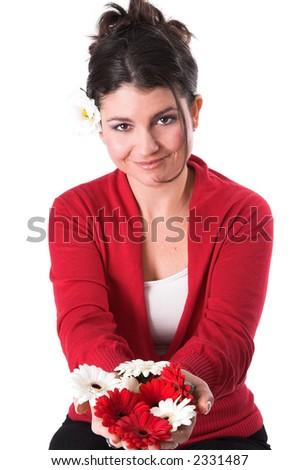 Beautiful woman holding out flowers in her hands on white background - stock photo