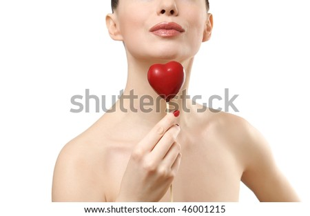 Beautiful woman holding red heart. Face closeup. Isolated on white background