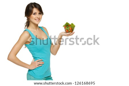 Beautiful woman holding transparent bowl with healthy salad meal, over white, with copy space