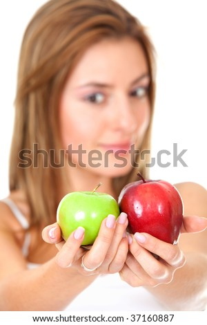 Beautiful woman holding two apples isolated over white
