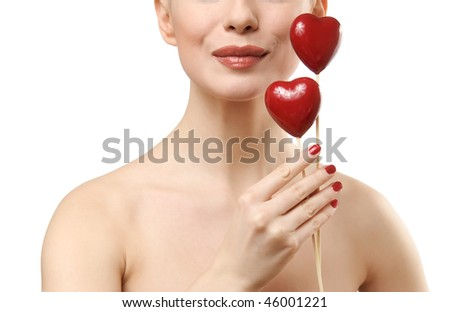 Beautiful woman holding two red hearts. Face closeup. Isolated on white background