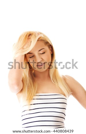 Beautiful woman holds a head, suffering from a headache. - stock photo