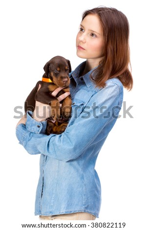 Beautiful woman holds red doberman dog puppy on her hands, isolated on white