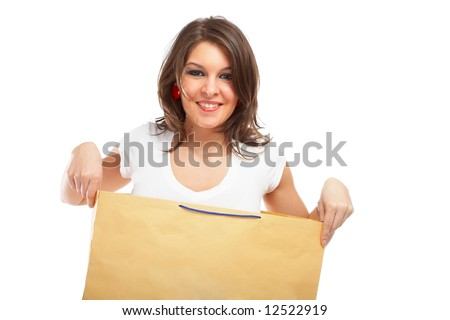 Beautiful woman in a bag over white background