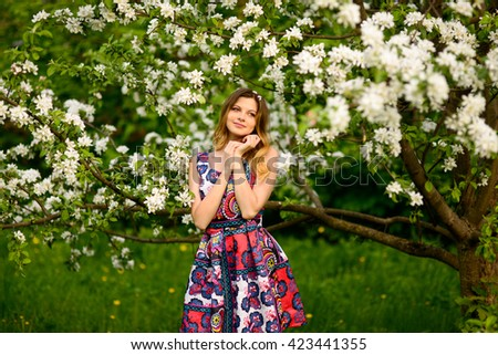 Beautiful woman in a blooming Apple orchard