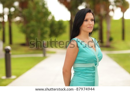 Beautiful woman in a blue dress