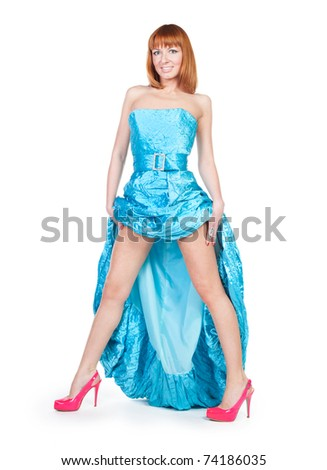 beautiful woman in a blue dress and red shoes on a white background