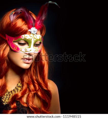 Beautiful Woman in a Carnival mask. Isolated on Black - stock photo