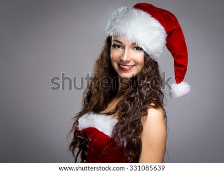 Beautiful woman in a Christmas suit - stock photo