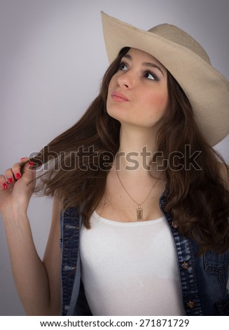 beautiful woman in a cowboy style